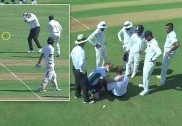 Umpire Reiffel off field after being hit on head by ball