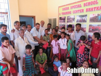 Fruits given to physically challenged students on Former Chief Ministers Bangarappa's birthday