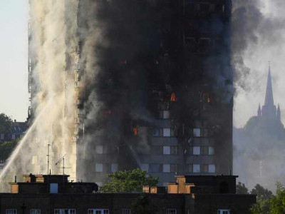 Huge fire engulfs London tower block, 30 people injured