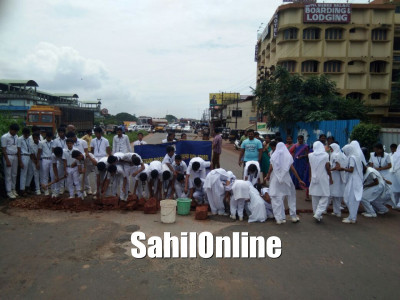 Fed up with NHAI's inaction, students fill potholes near their school