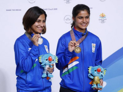 Brilliant Manu nails gold, Heena wins silver