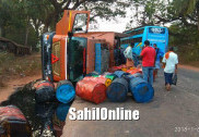 Truck laden with barrels of tar topples over on Honnavar NH-66