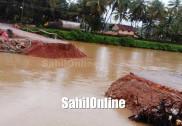 بھٹکل میں موسلادھار بارش؛ شرالی سے الوے کوڈی کو جوڑنے والی عارضی سڑک پانی میں بہہ گئی