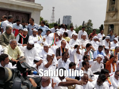 Congress-JDS leaders stages protest against the swearing in of B S Yeddyurappa as chief minister.