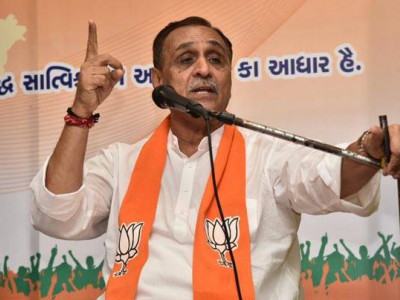 Gujarat CM fires IAS Rajput over corruption allegations
