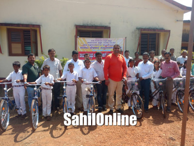 Bhatkal MLA Sunil Naik distributes free bicycles to school students
