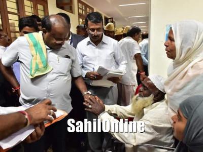 CM Kumaraswamy interacts with people during 'Janata Darshana' program in Belgaum