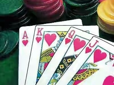 24 held after raid on gambling den