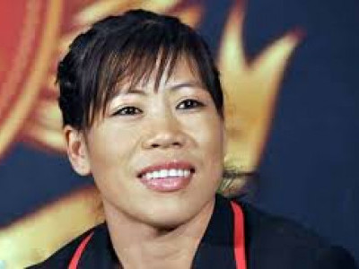 Mary Kom wins first bout, assured of medal