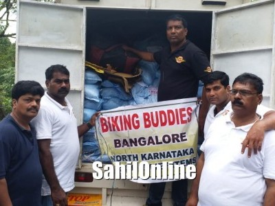 99 canons motorcycle club, Sirsi and old fish market association, Sirsi jointly distributed relief materials to flood-affected victims in Kadra near Karwar