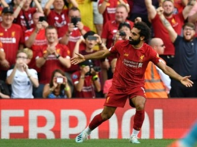 Salah steers Liverpool past Arsenal; Palace stun United