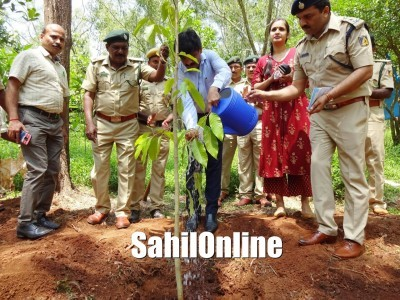 Deputy Commissioner G Jagadheesha plants a sapling as a part of 'Vrakshothsava'  at Udupi