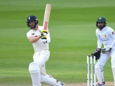 Buttler, Woakes give England improbable win against