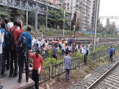 Members of Bahujan Kranti Morcha block railway track during anti CAA, NRC protest in Mumbai