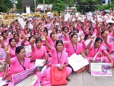 Asha workers stage a protest in front of DHO's office in Udupi