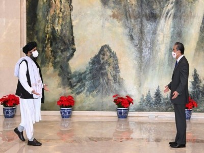 China provides USD 1mn to Afghanistan after Wang Yi, Mullah Baradar meet in Doha